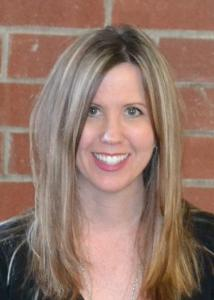Headshot of Sandee Kyler with long light brown hair and black blouse.