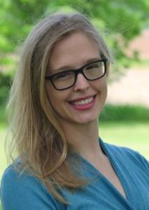 Headshot of Sarah Font outdoors with long blonde hair wearing glasses and blue top.