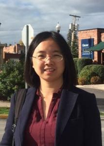 Headshot of Siwei Liu with black hair, glasses, maroon blouse, and black jacket.
