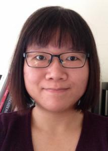 Headshot of Xiao Yang with short dark hair, glasses, and maroon blouse.
