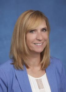 Kimberly Lawless headshot in blue suit
